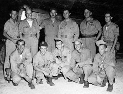 Paul Tibbets and his flight crew in their flight suits